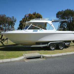 Photo of CARIBBEAN 23.5FT CABIN CRUISER BOAT